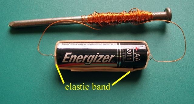 The Elastic Band Holds Each End Of Wire Against Battery Terminals Only Use A 15 Volt AA With This Electromagnet